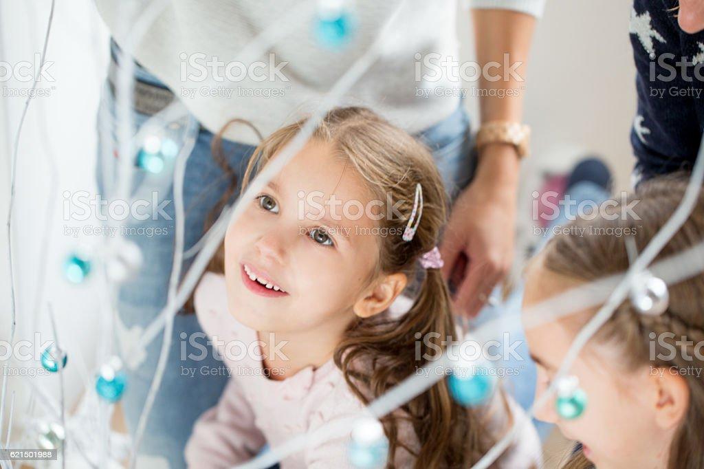 Little Girl Staring at Christmas Decorations Lizenzfreies stock-foto