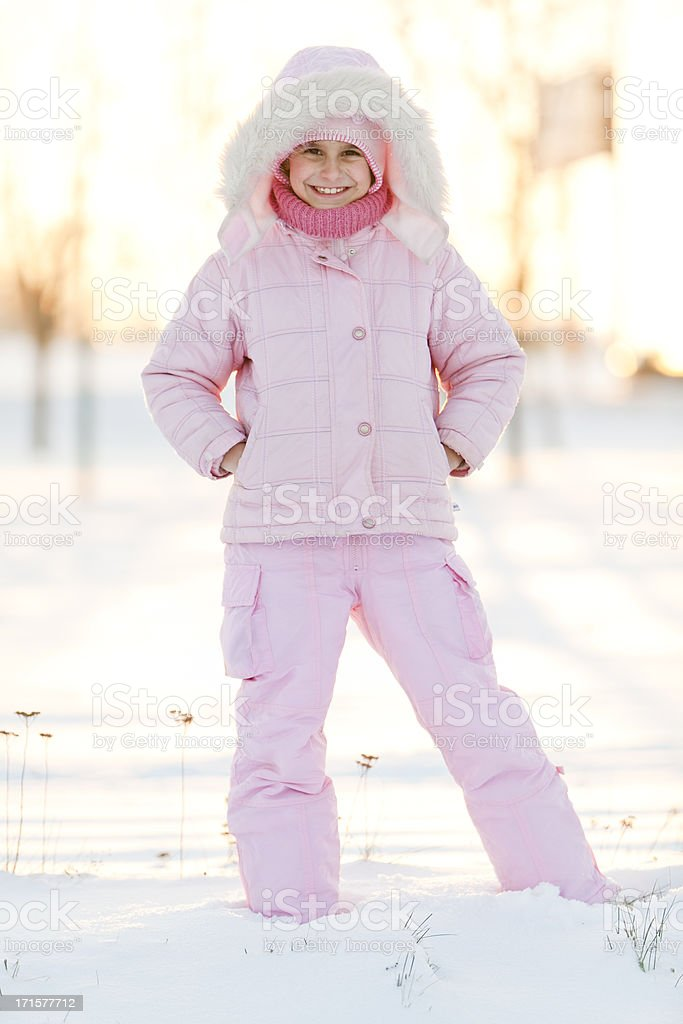 Little girl stay on the winter's snow-covered road royalty-free stock photo