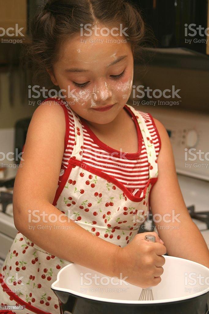 Little Girl Stirring royalty-free stock photo