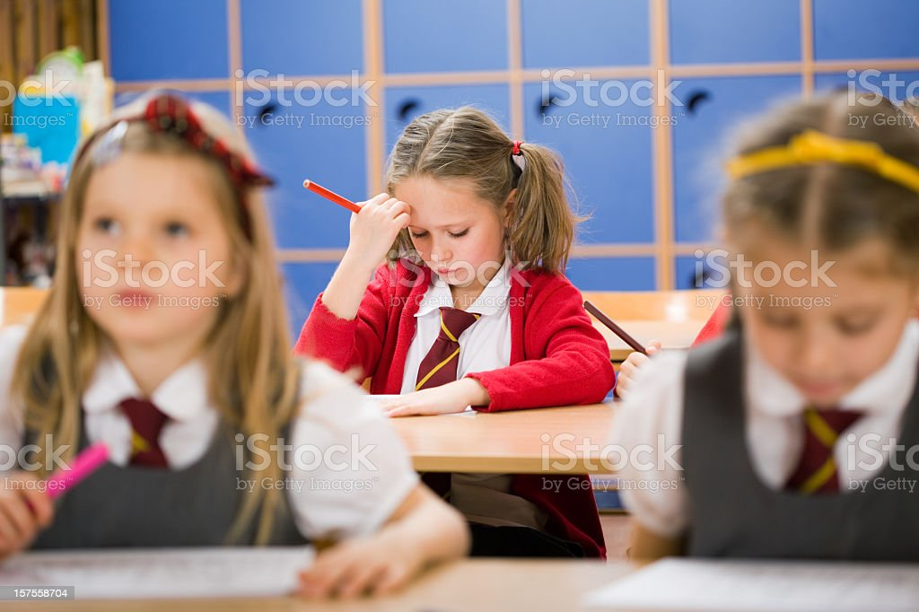 Little Girl Struggling With School Work stock photo