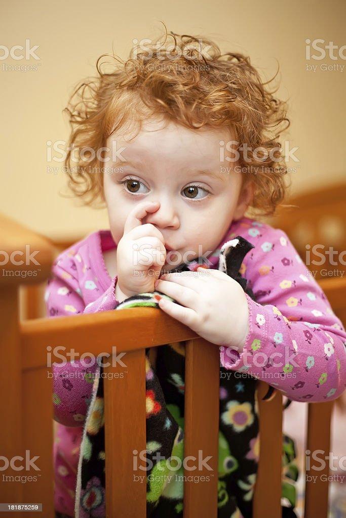 Little Girl Sucking Thumb in Crib royalty-free stock photo