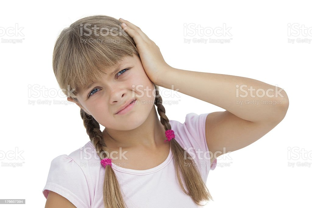 Little girl suffering from earache stock photo