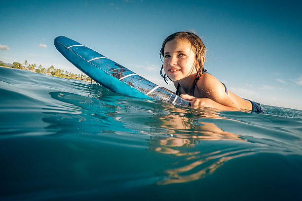 Little Girl Surfing in Hawaii stock photo
