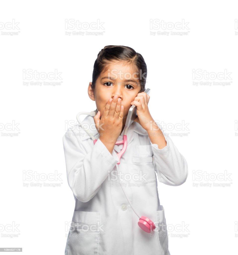 Little girl surprise talking on the phone stock photo