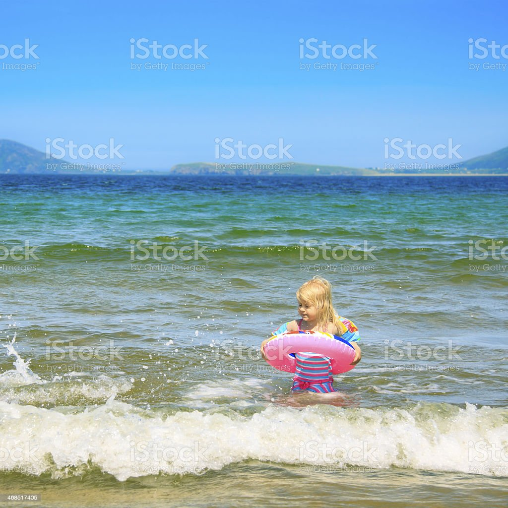 Little Girl swimming in the sea. stock photo