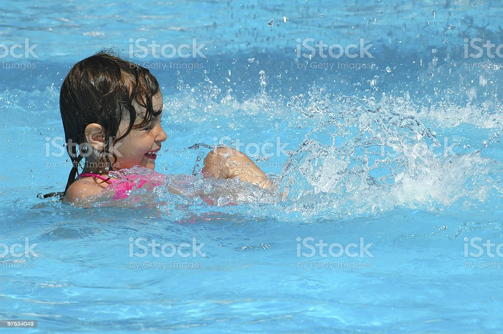 Little girl swimming in water pool royalty-free stock photo