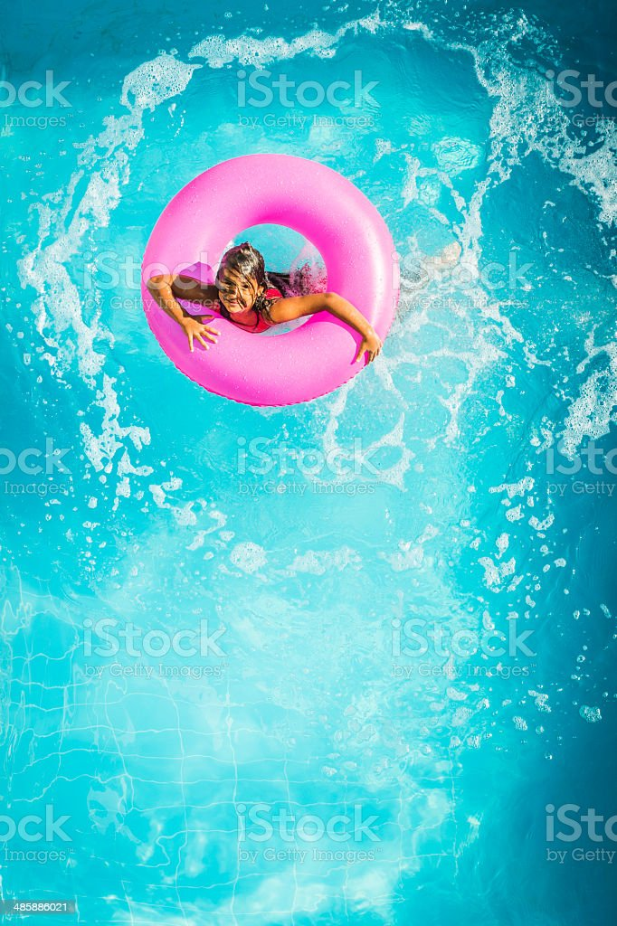 Little girl swimming stock photo