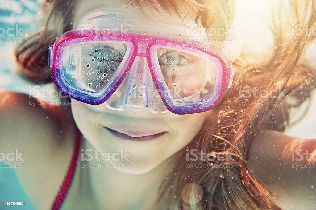 Little girl swimming underwater royalty-free stock photo