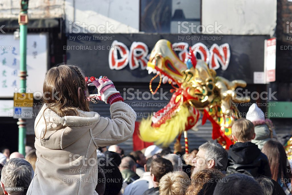 Little girl taking a photo of Chinese Dragon royalty-free stock photo