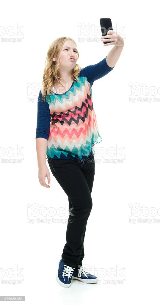 Little girl taking a selfie stock photo