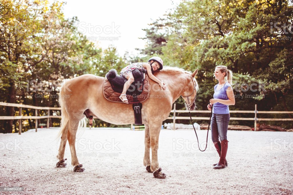 Little Girl Taking Horse-Riding Lessons stock photo