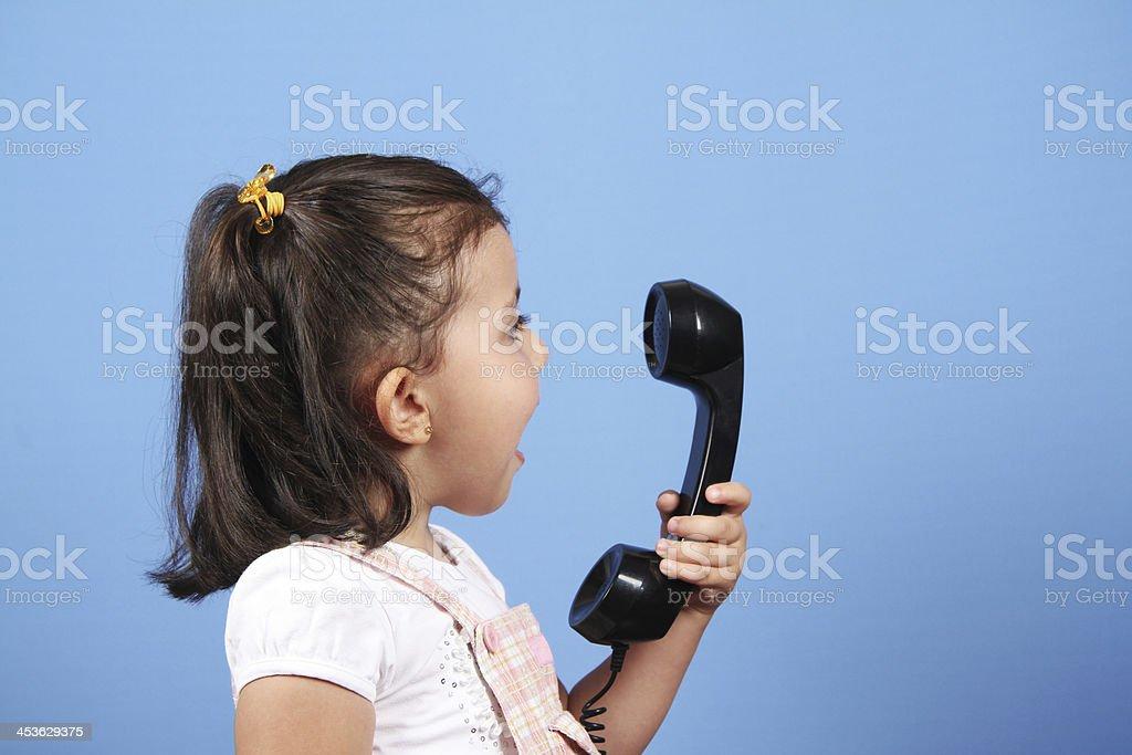 Little girl talk on the phone stock photo