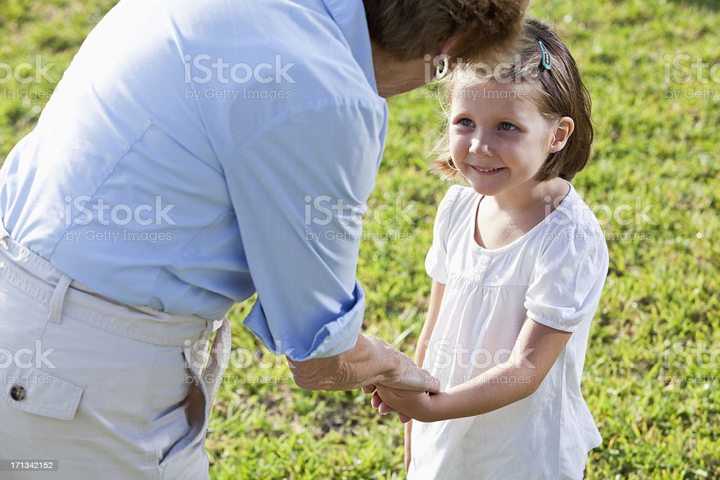 Little girl talking with grandmother royalty-free stock photo