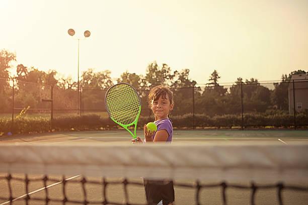 little girl tennis player stock photo