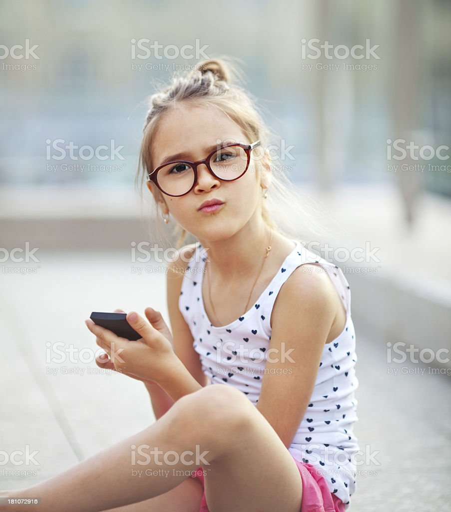 Little Girl Text Messaging on cell phone royalty-free stock photo