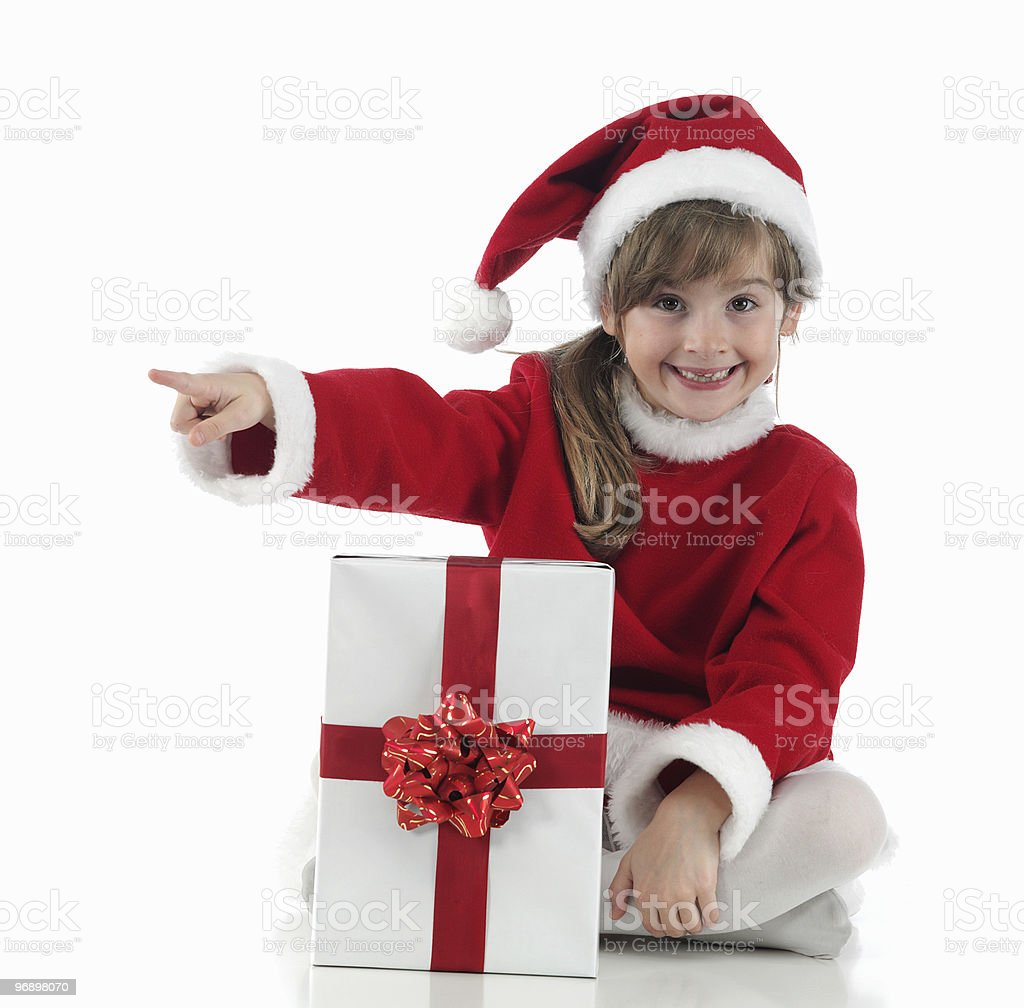 little girl that indicates and xmas presents royalty-free stock photo