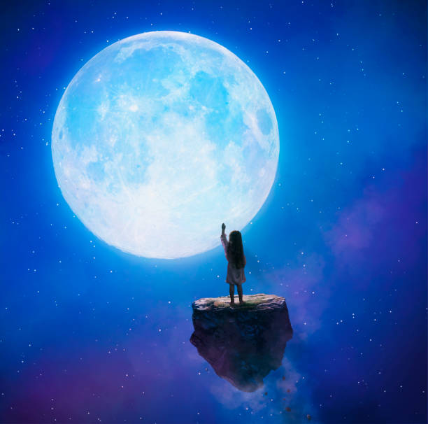 little girl touching the moon - moon stock photos and pictures