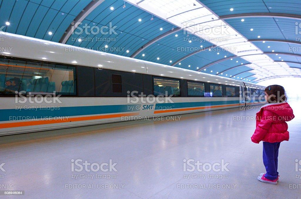 Little girl travel on Shanghai Maglev Train stock photo
