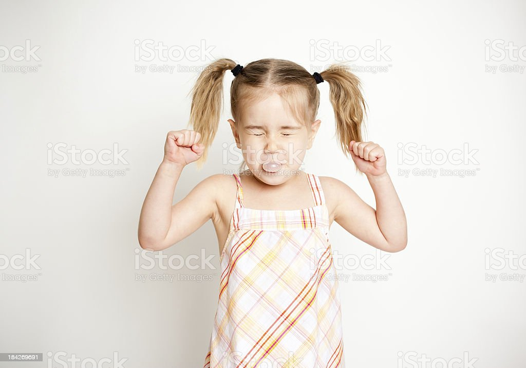 Little Girl Trying Really Hard to Blow Her Bubble Gum stock photo
