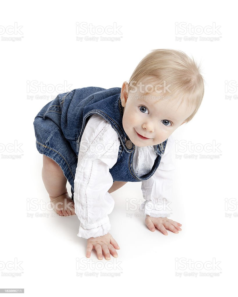 Little girl trying to stand up royalty-free stock photo