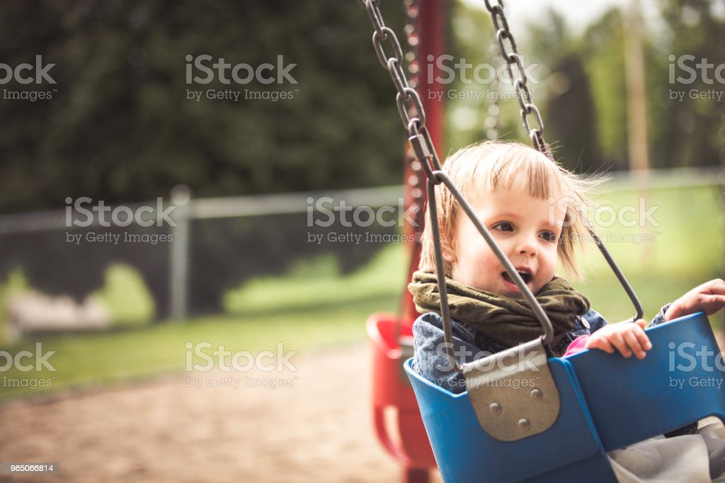 Little girl using a swing royalty-free stock photo