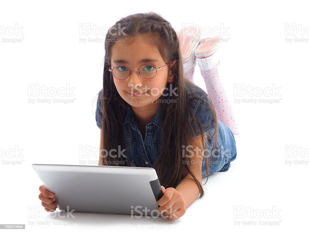 Little girl using tablet pc royalty-free stock photo