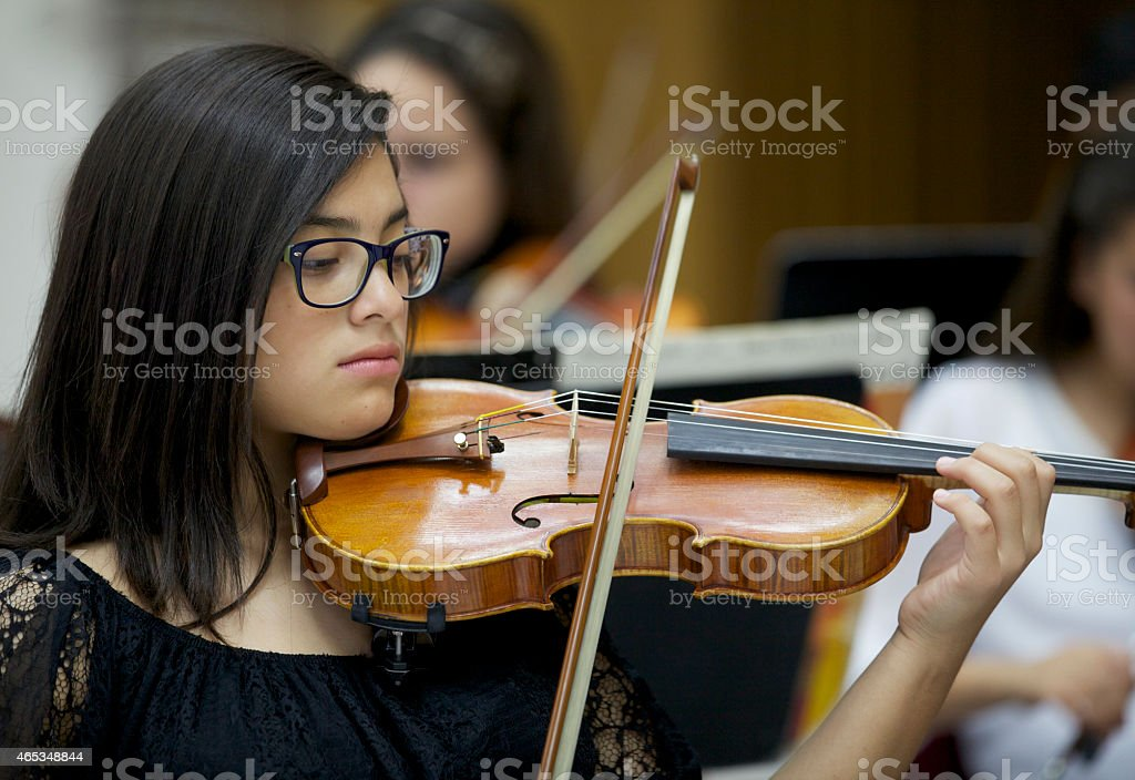 little girl  violin player  in  concert stock photo