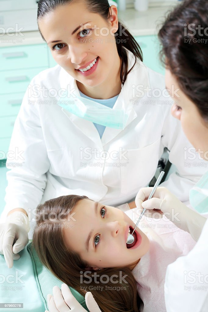 Little girl visiting a dentist. royalty-free stock photo