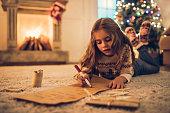 istock Little girl waiting for Christmas. 882323108