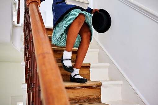 Little girl walking down the stairs