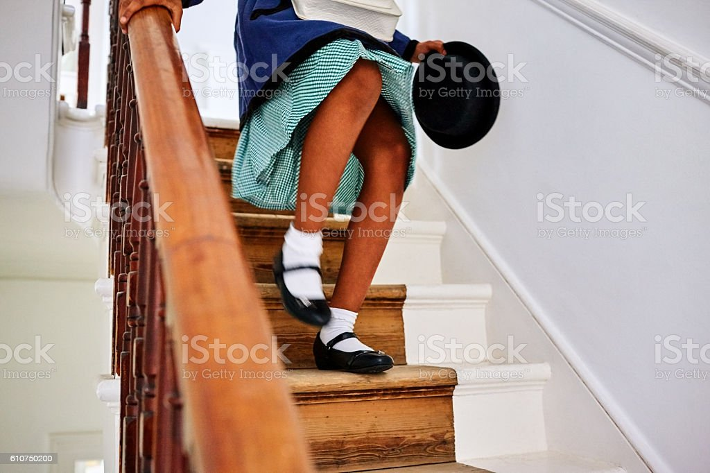 Little girl walking down the stairs stock photo