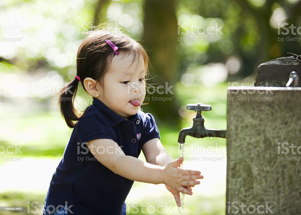 Little girl washing hands royalty-free stock photo