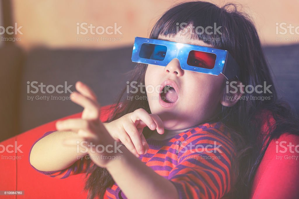 Little girl watching a 3D movie stock photo