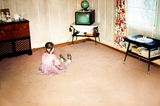 Little Girl Watching First Television, Retro Vintage Style stock photo