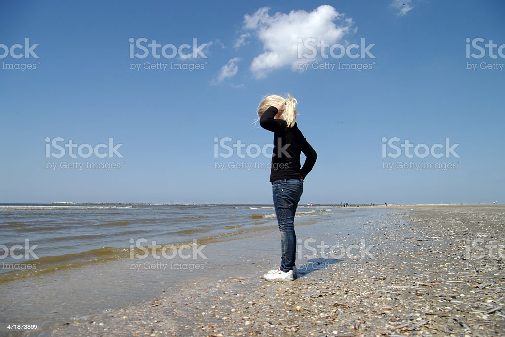 Little girl watching the sea royalty-free stock photo