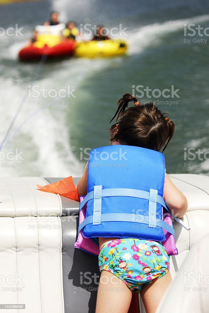 Little Girl Watching Watersports stock photo