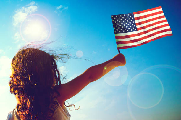 Little girl waving American flag stock photo