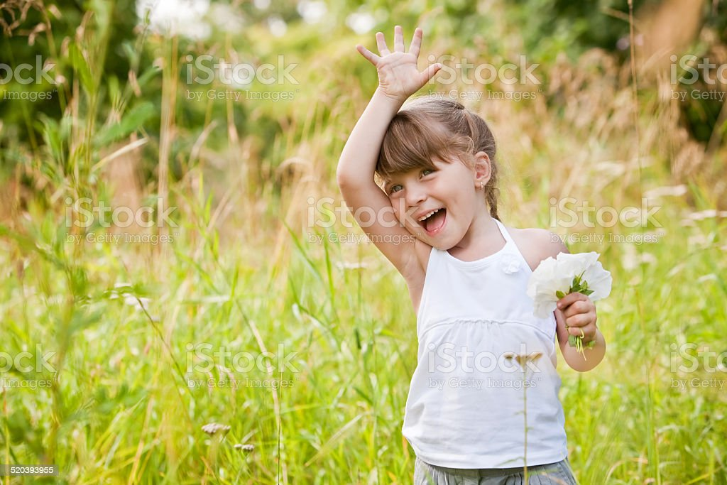 Little Girl Waving High stock photo