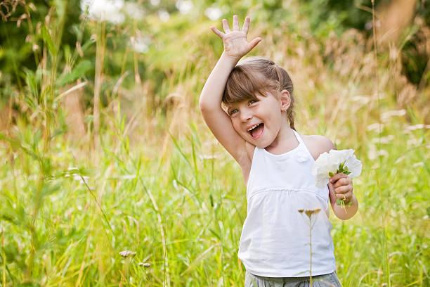 Little Girl Waving High stock photo