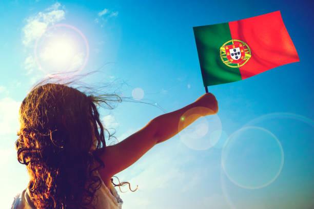 Little girl waving Portuguese Flag stock photo