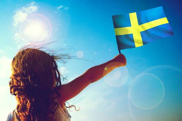 Little girl waving Swedish Flag stock photo