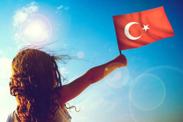 Little girl waving Turkish flag Little girl waving Turkish flag on sunny beautiful day independence day holiday stock pictures, royalty-free photos & images
