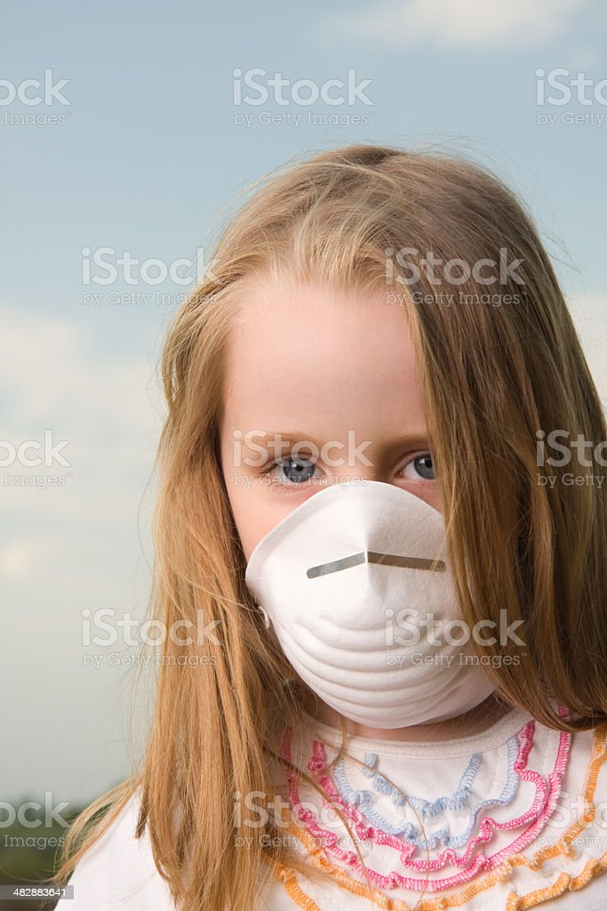 Little girl wear protective mask royalty-free stock photo