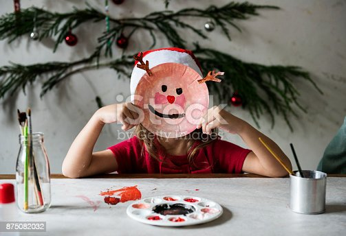 istock Little girl wearing a reindeer mask  875082032