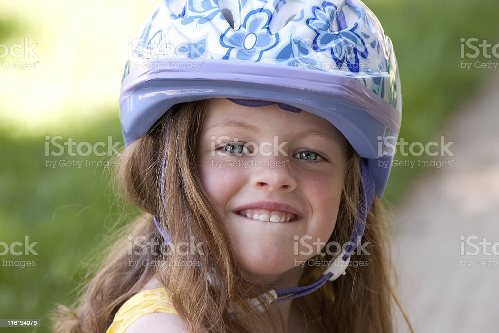 LIttle girl wearing bike helmet royalty-free stock photo