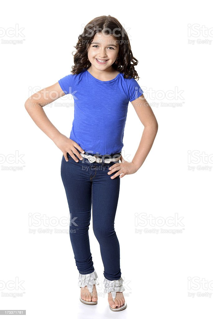 little girl wearing blue jeans with hands on hips stock photo
