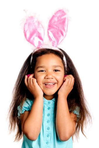Little Girl Wearing Bunny Ears on White Background