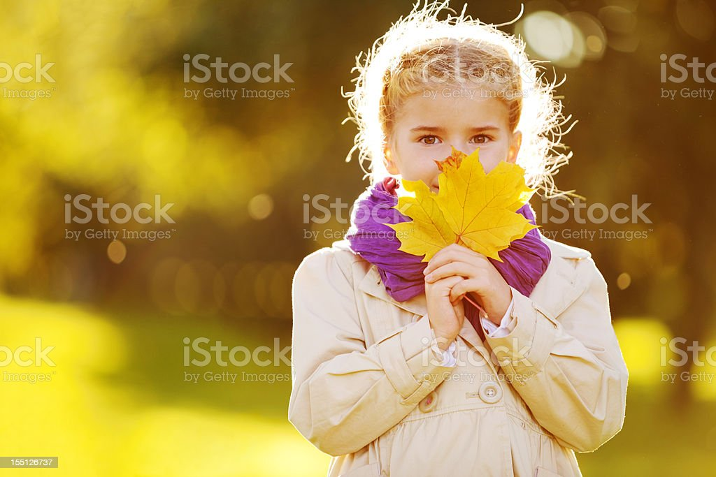Little Girl Wearing Coat and Purple Scarf royalty-free stock photo