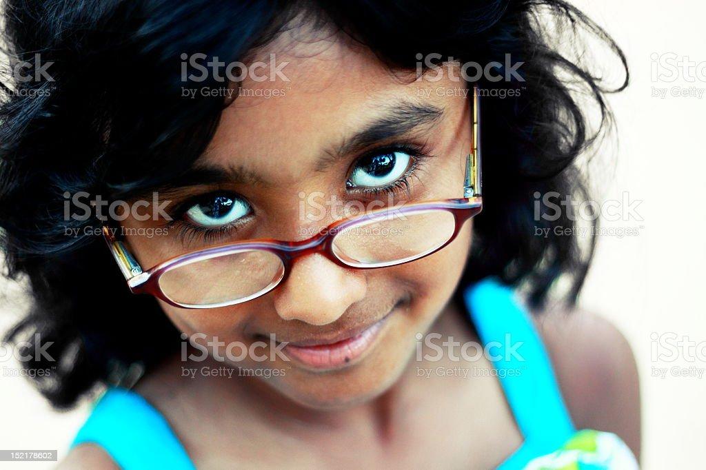 Little Girl Wearing Eyesight Glasses stock photo