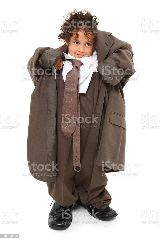 Little girl wearing grown up man's business suit stock photo